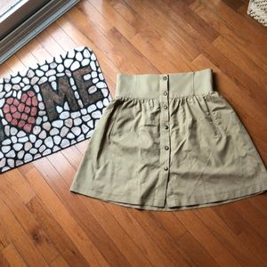 Tan skirt with forgiving waist.
